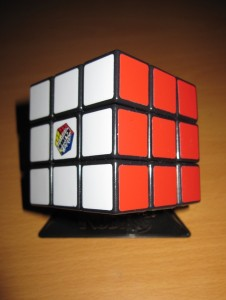 Red and white sides of a Rubik's Cube completed.